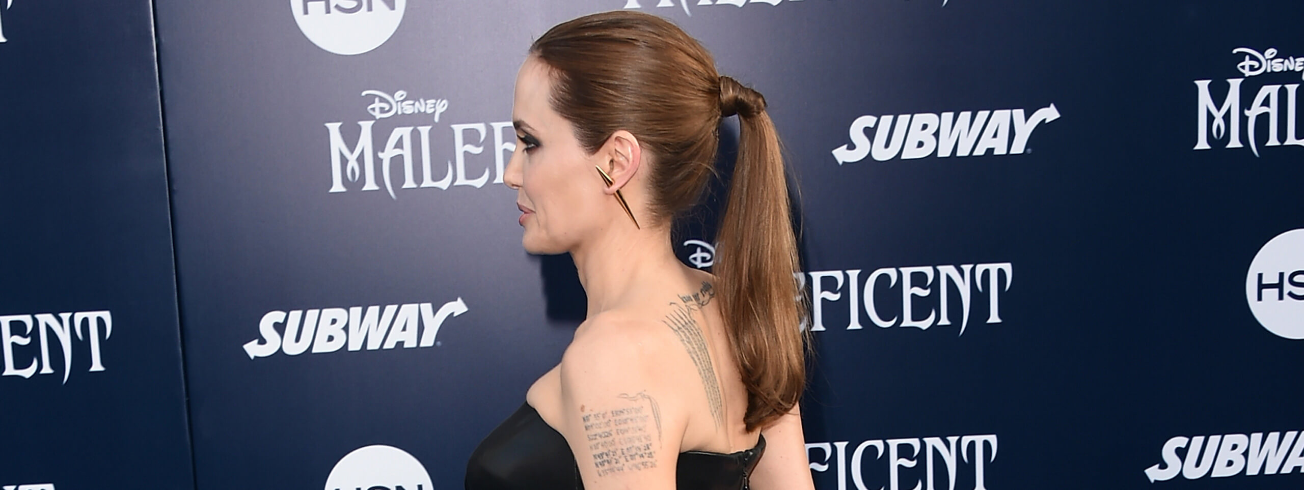 Angelina Jolie with her hair tied in a classic ponytail hairstyle