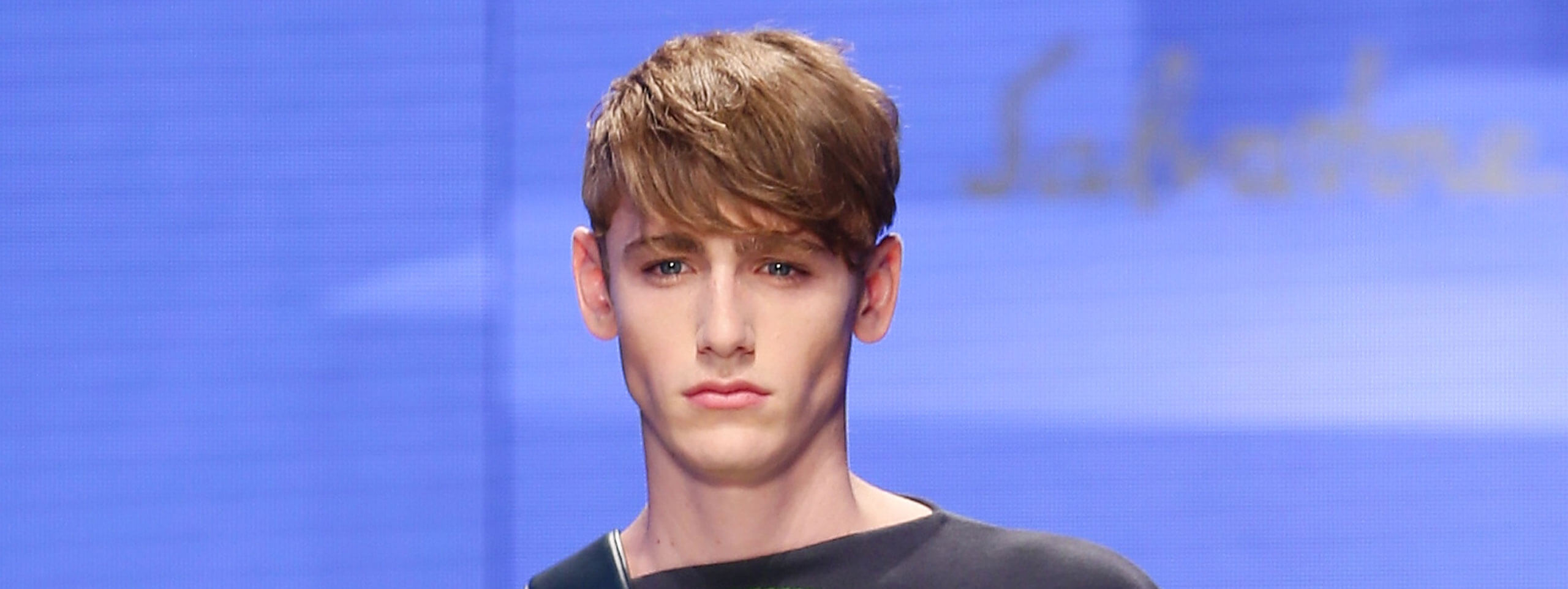 Male model with short hairstyle and long fringe