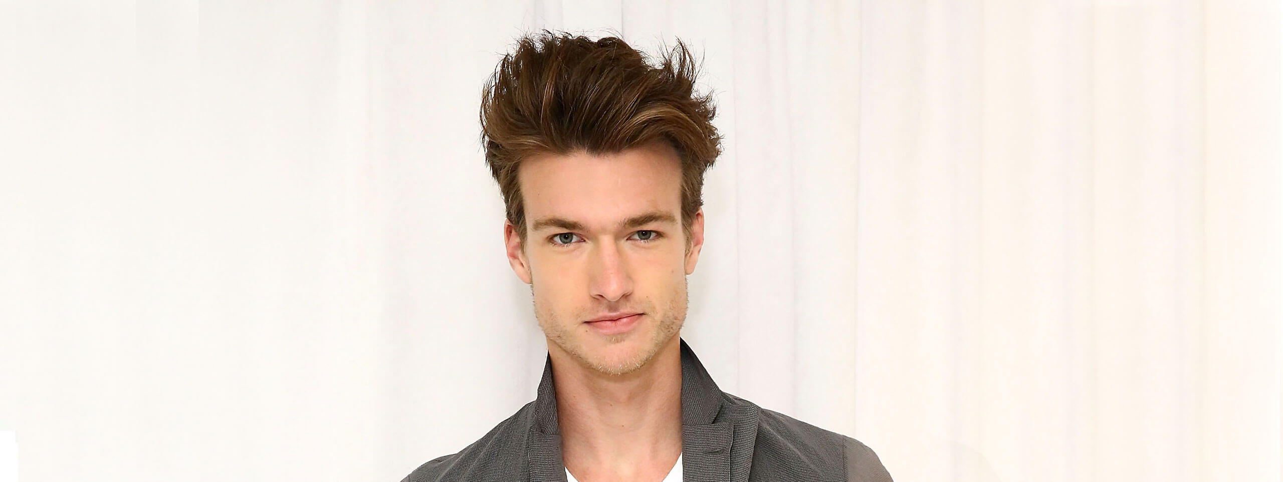 Man with short dark hairstyle, a popular hairstyle trend for men