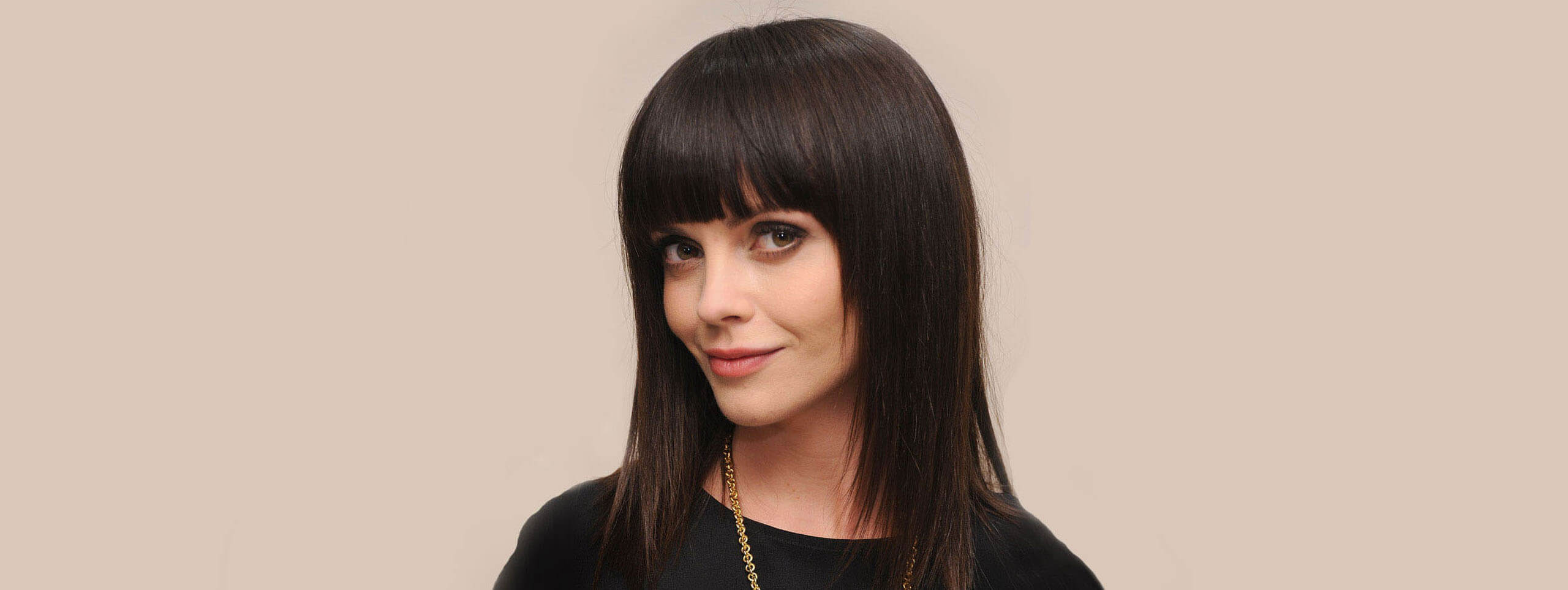 Model with a straight fringe hairstyle and bangs