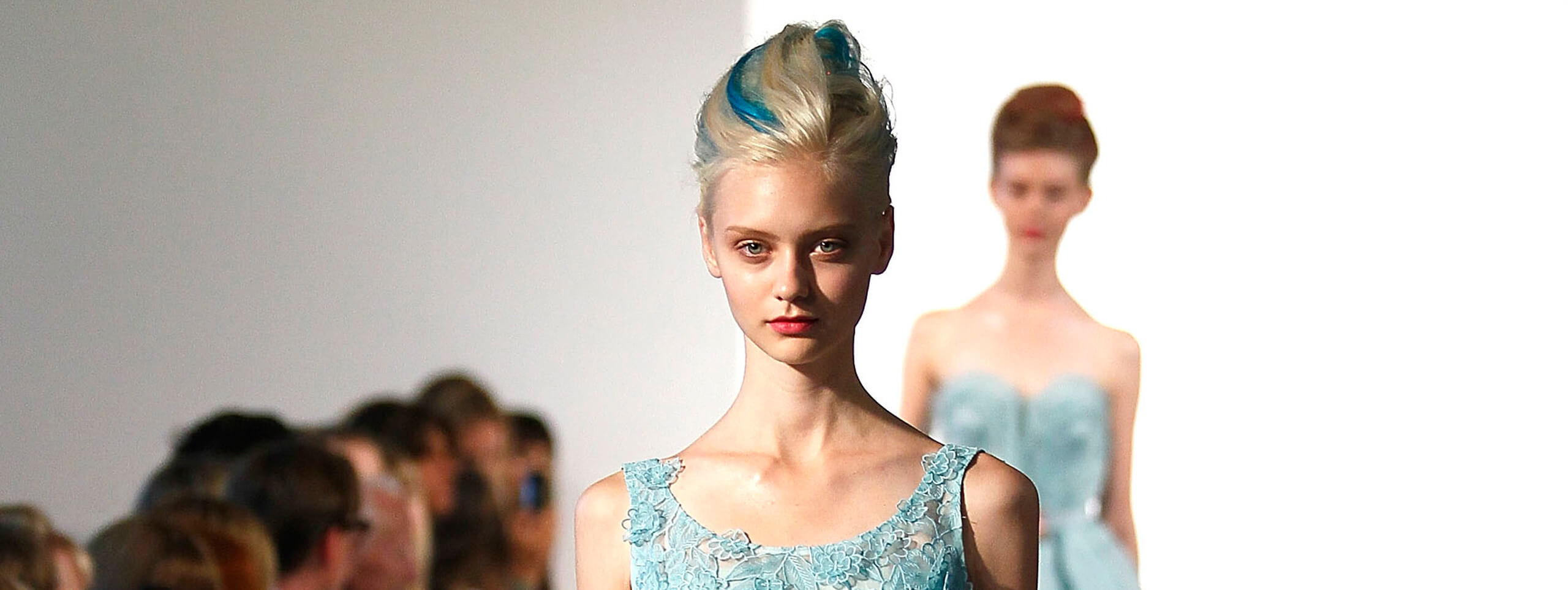 Model with a streaked hairstyle on the runway