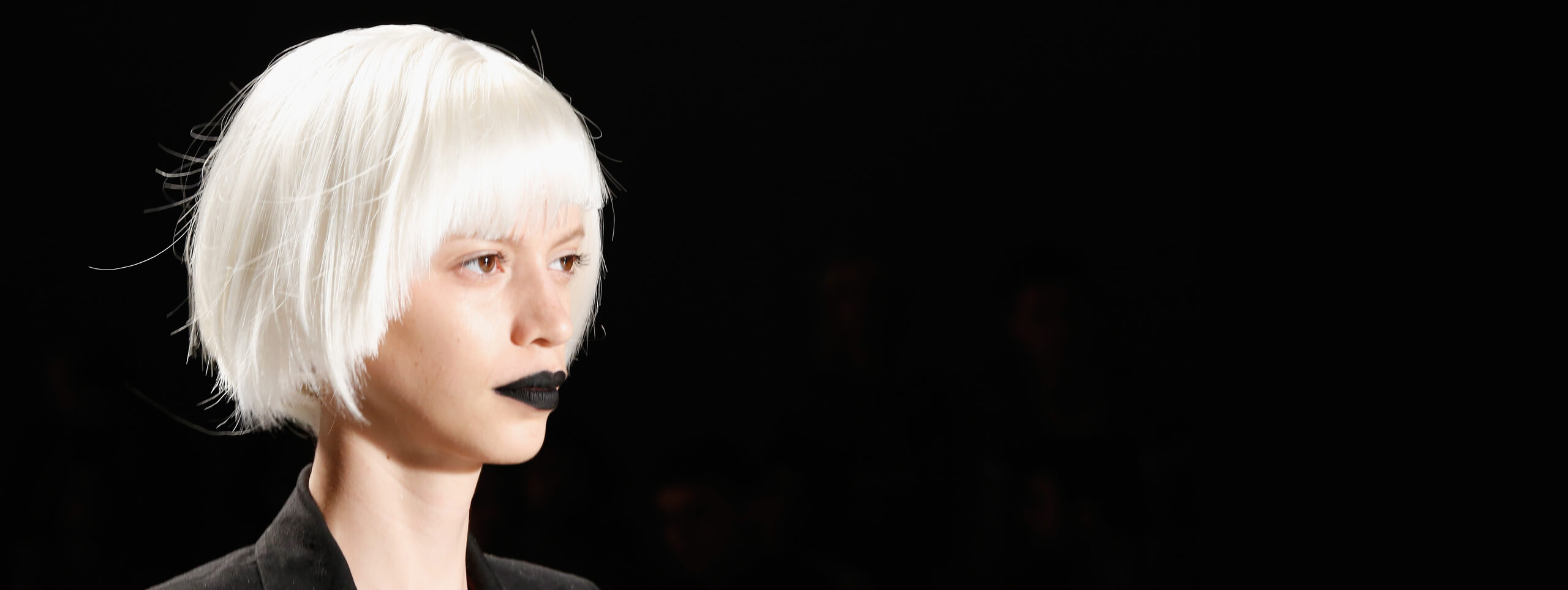 Model with a white bob hairstyle and black lipstick