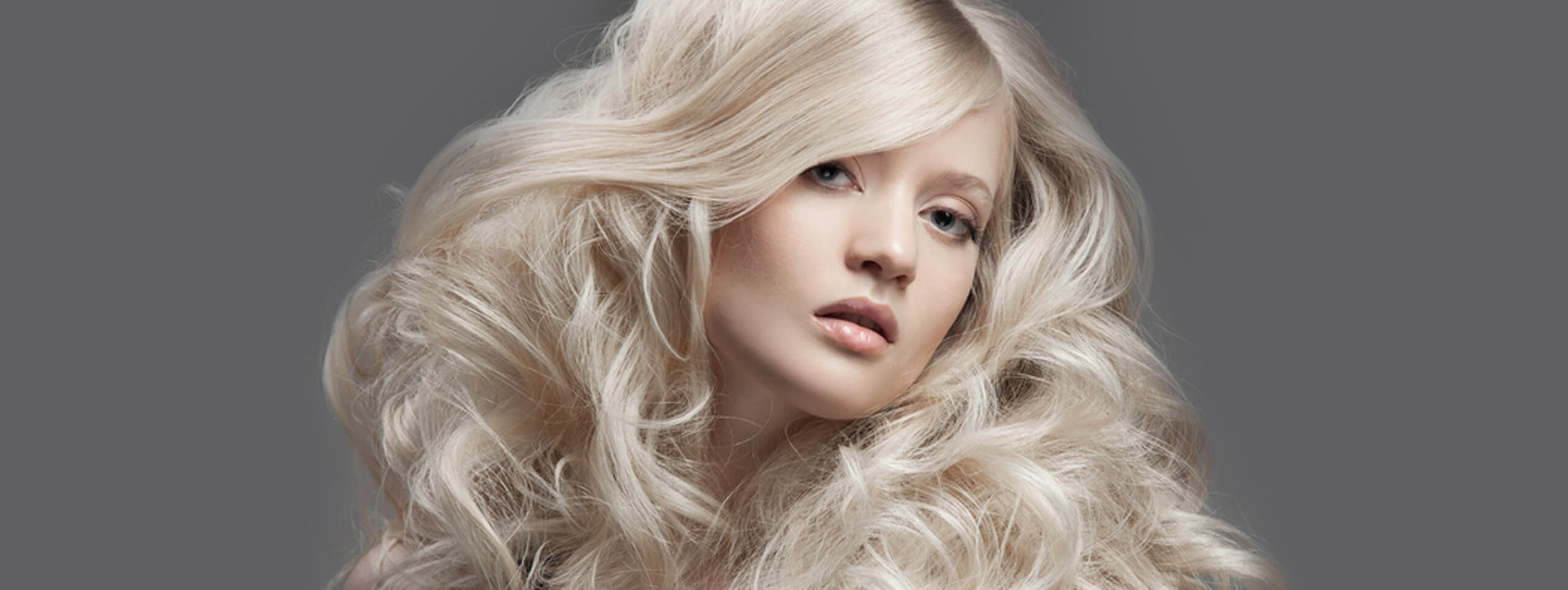 Model with blonde curly hairstyle