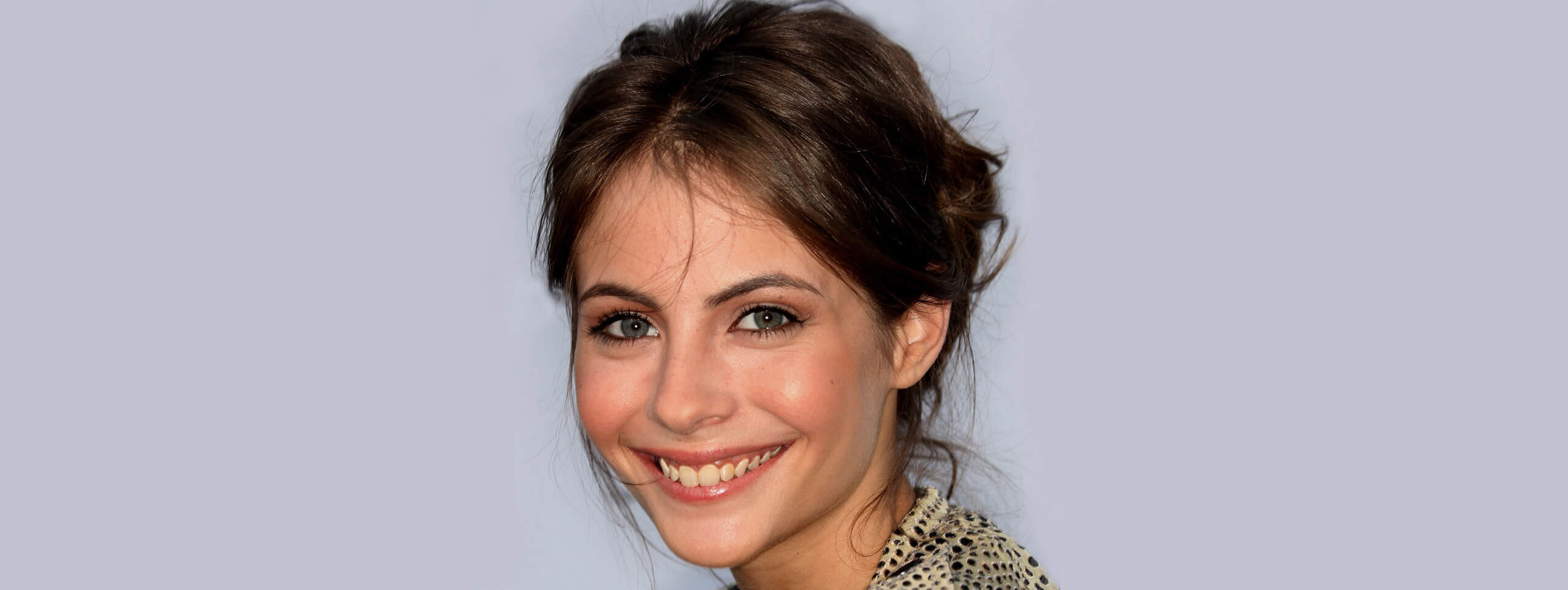 Willa Holland wears hair in low updo hairstyle