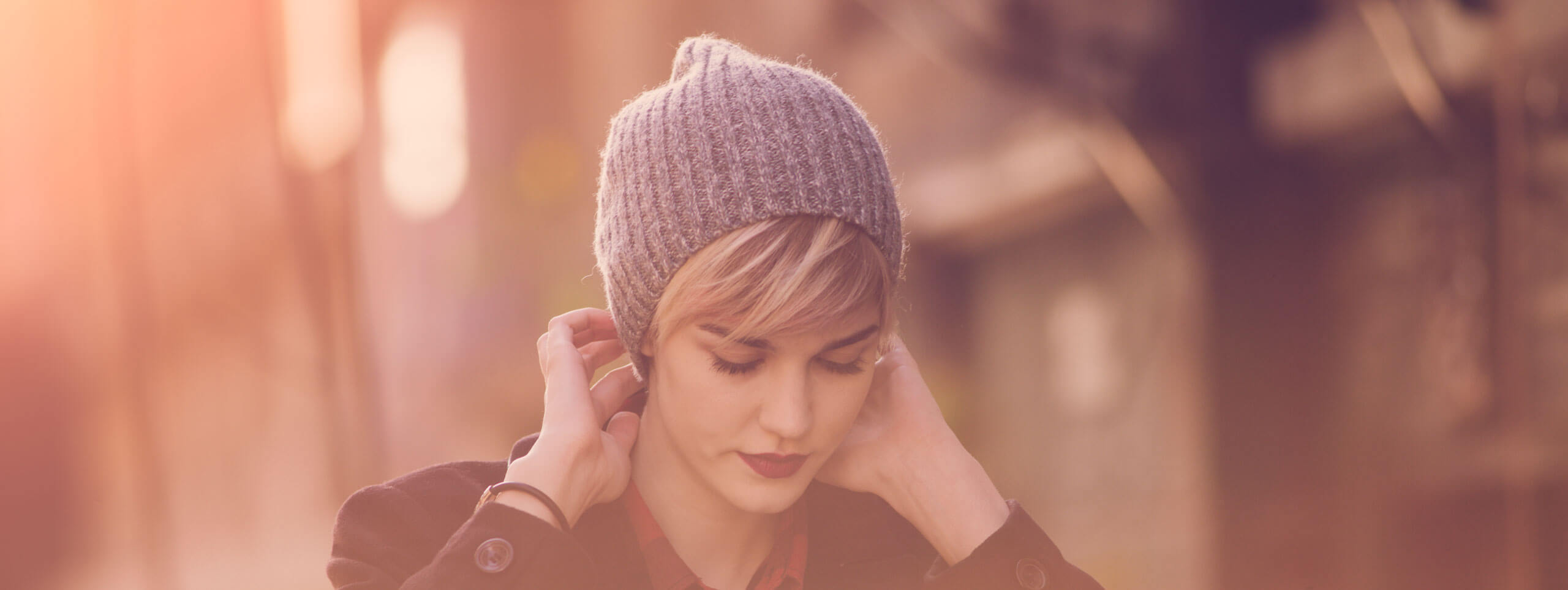 Woman wearing beanie hat with pixie haircut