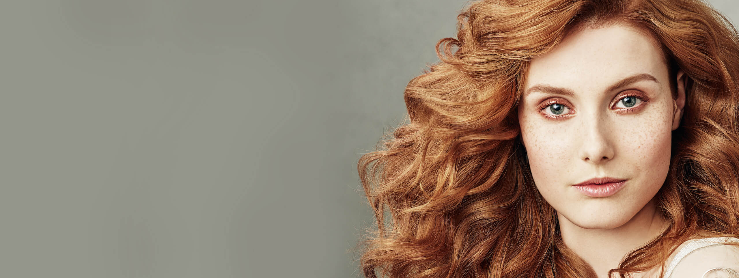 Woman with big wavy red hairstyle