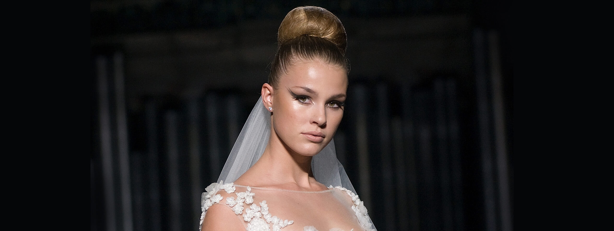 Woman with hair in high bun updo hairstyle for wedding