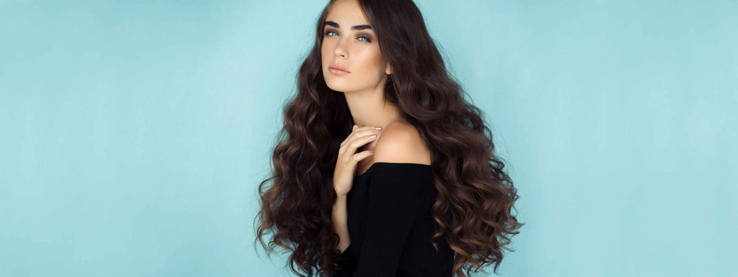 Woman with long naturally curly hairstyle