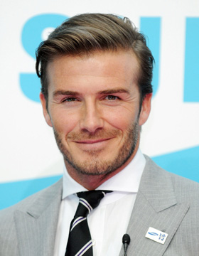 David Beckham wearing a side-parted hair style