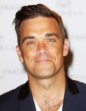 Robbie Williams wearing a side-parted hair style